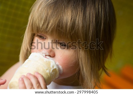 Little girl eating ice cream in the park and dirty. - stock photo