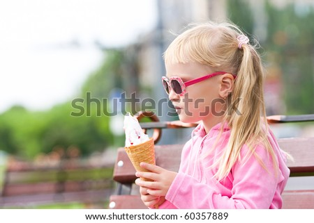 Little girl eating icecream - stock photo
