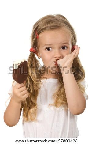 Little girl eating icecream licking fingers - isolated - stock photo