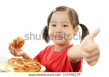 Little girl eating meal - stock photo
