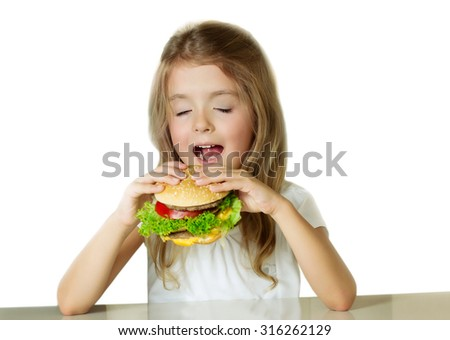 Little girl eating sandwich.Child with hamburger.Isolated on white background.