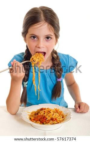 little girl eating spaghetti - stock photo