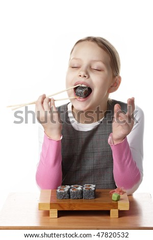 Little girl eating sushi - stock photo