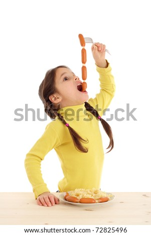 Little girl eating the chain of sausages, isolated on white - stock photo