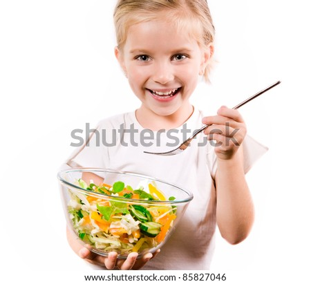 Little girl eating vegetable salad - healthy food concept - stock photo