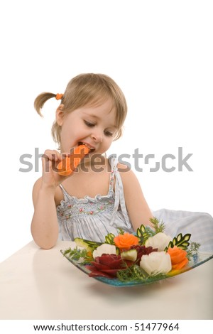little girl eating vegetables - chomping a carrot - isolated