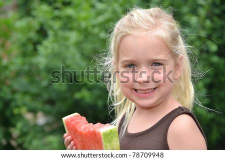 little girl eating watermelon - stock photo