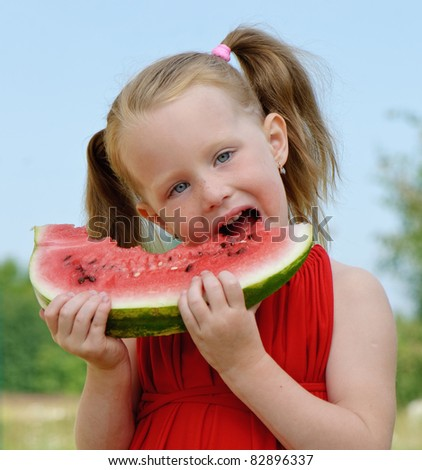 little girl eating watermelon - stock photo