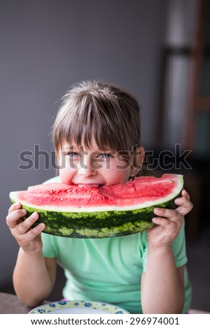 Little girl eating watermelon. Shallow depth of field  - stock photo