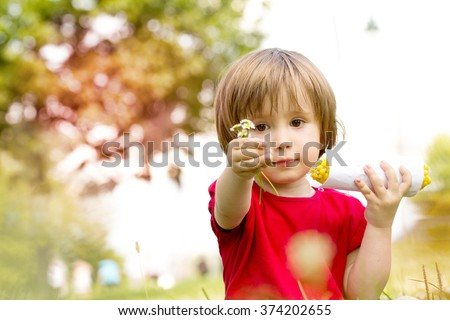 little girl eats corn