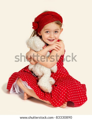 Little girl Embracing her Teddy Bear on white background - stock photo