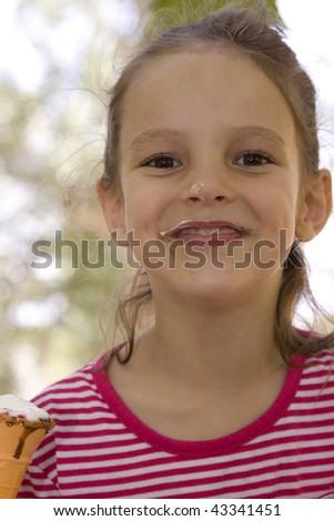 little girl enjoying an ice cream cone - stock photo