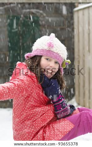 Little girl enjoying the snow. - stock photo