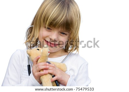 Little girl examines her teddy bear with a stethoscope. - stock photo
