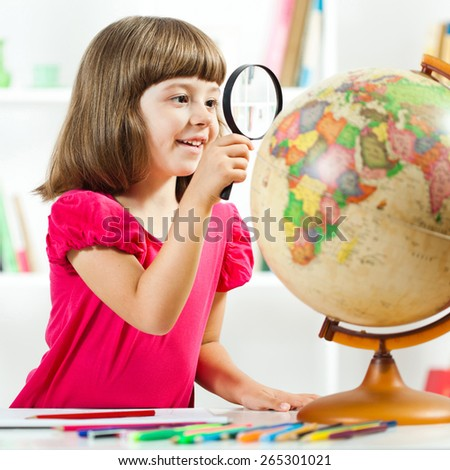 Little girl exploring planet earth and drawing in sketchbook - stock photo