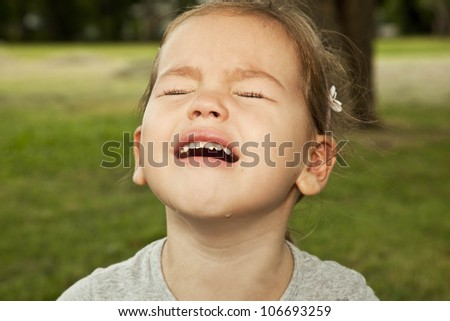 Little girl face crying - stock photo
