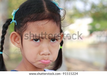 Little girl face crying. closeup useful as for design-works. - stock photo
