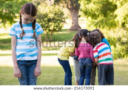 Little girl feeling left out in park on a sunny day - stock photo
