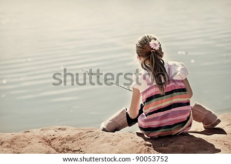 Little Girl fishing on a pond - stock photo