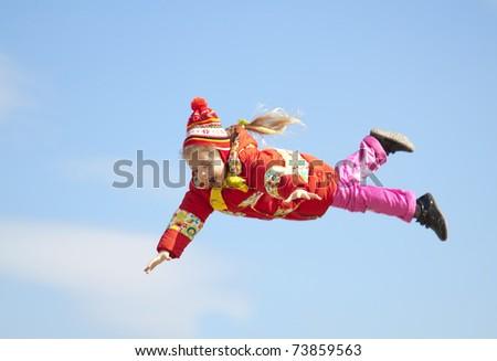 Little girl fly in the sky. - stock photo