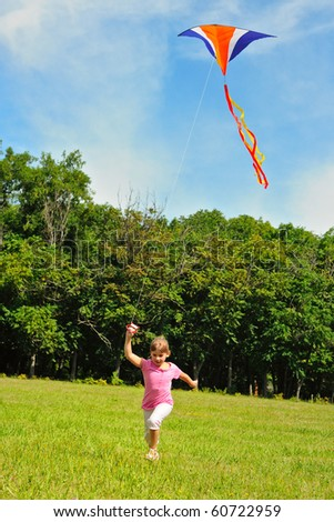 Little girl flying a kite