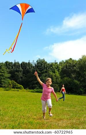 Little girl flying a kite - stock photo