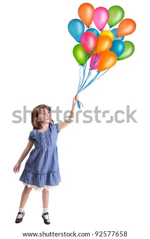 Little girl flying with colorful balloons - stock photo