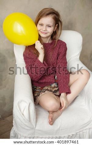 Little girl fooling in the studio, hamming, posing, having fun, enjoying life, carefree childhood - stock photo