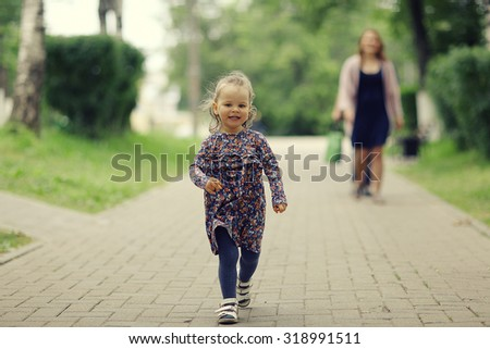 little girl for a walk in the park - stock photo