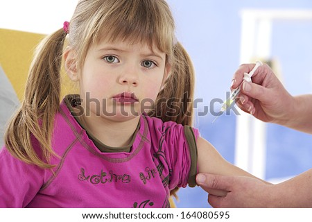 Little girl getting an injection or vaccine  - stock photo