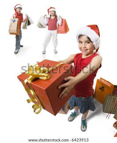 little girl giving a present to someone, while other childs waits behind her. - stock photo
