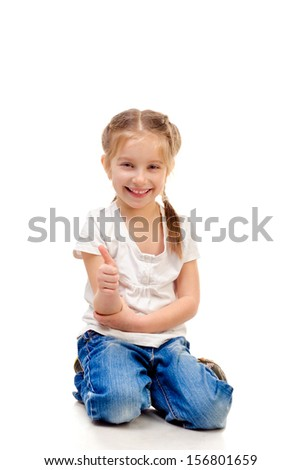 little girl giving a thumb up isolated on a white background