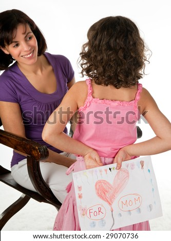 Little girl giving her mother a drawing for mother's day - stock photo