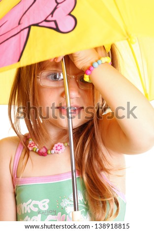 Little Girl glasses standing with yellow umbrella