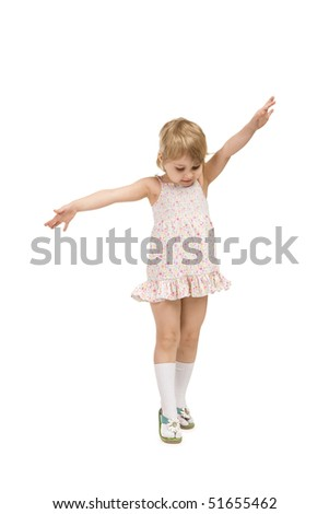 little girl goes on tiptoe on a white background