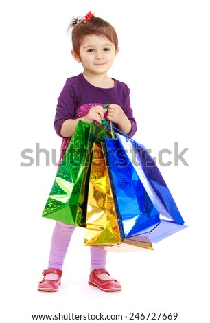 Little girl goes shopping with large colored blocks.concept childhood education and child development.Isolated on white background - stock photo