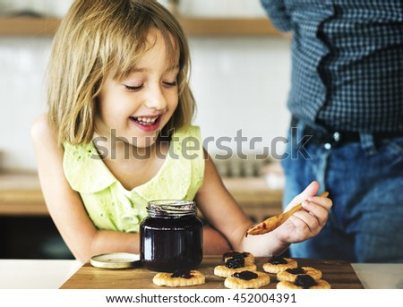 Little Girl Grandfather Bake Cookie Concept - stock photo