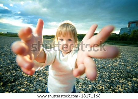 little girl grief look and reach out hands - stock photo