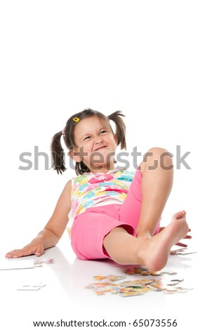Little girl grimacing over white