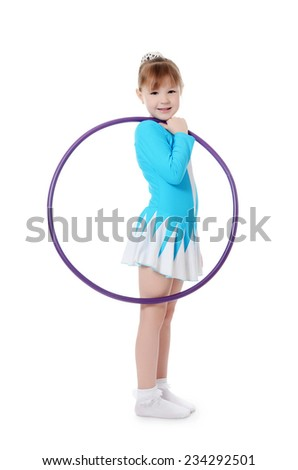 Little girl gymnast does exercise with hoop - stock photo
