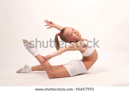 little girl gymnast performs an exercise