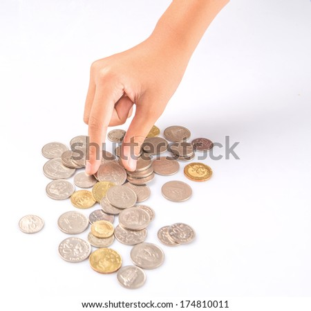 Little girl hand picking up coins