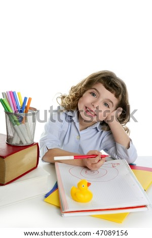 little girl happy student on desk writing and smiling