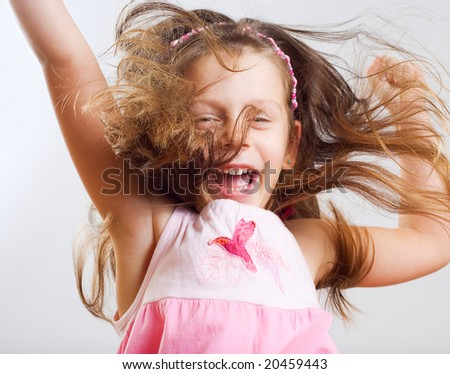 Little girl have a fun. - stock photo