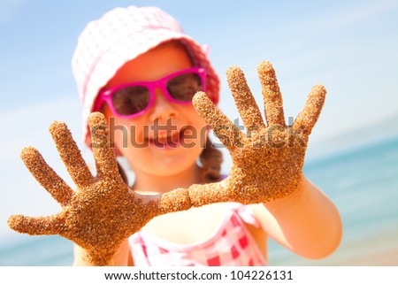 Little girl have a good time of resort beach - stock photo