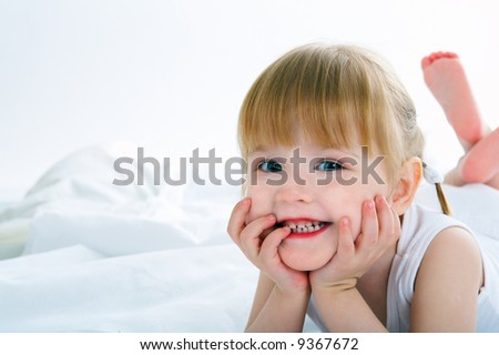 little girl have fun in bed - stock photo