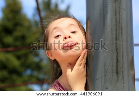 Little girl have fun on the playground - stock photo
