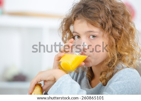 Little girl having a drink