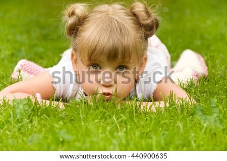 little girl having fun in the park. joy - stock photo