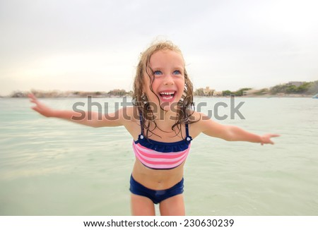 Little girl having fun in the sea. - stock photo